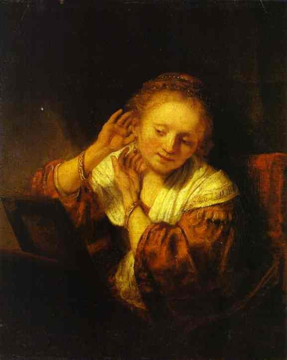 Woman Trying on Earrings - Rembrandt van Rijn